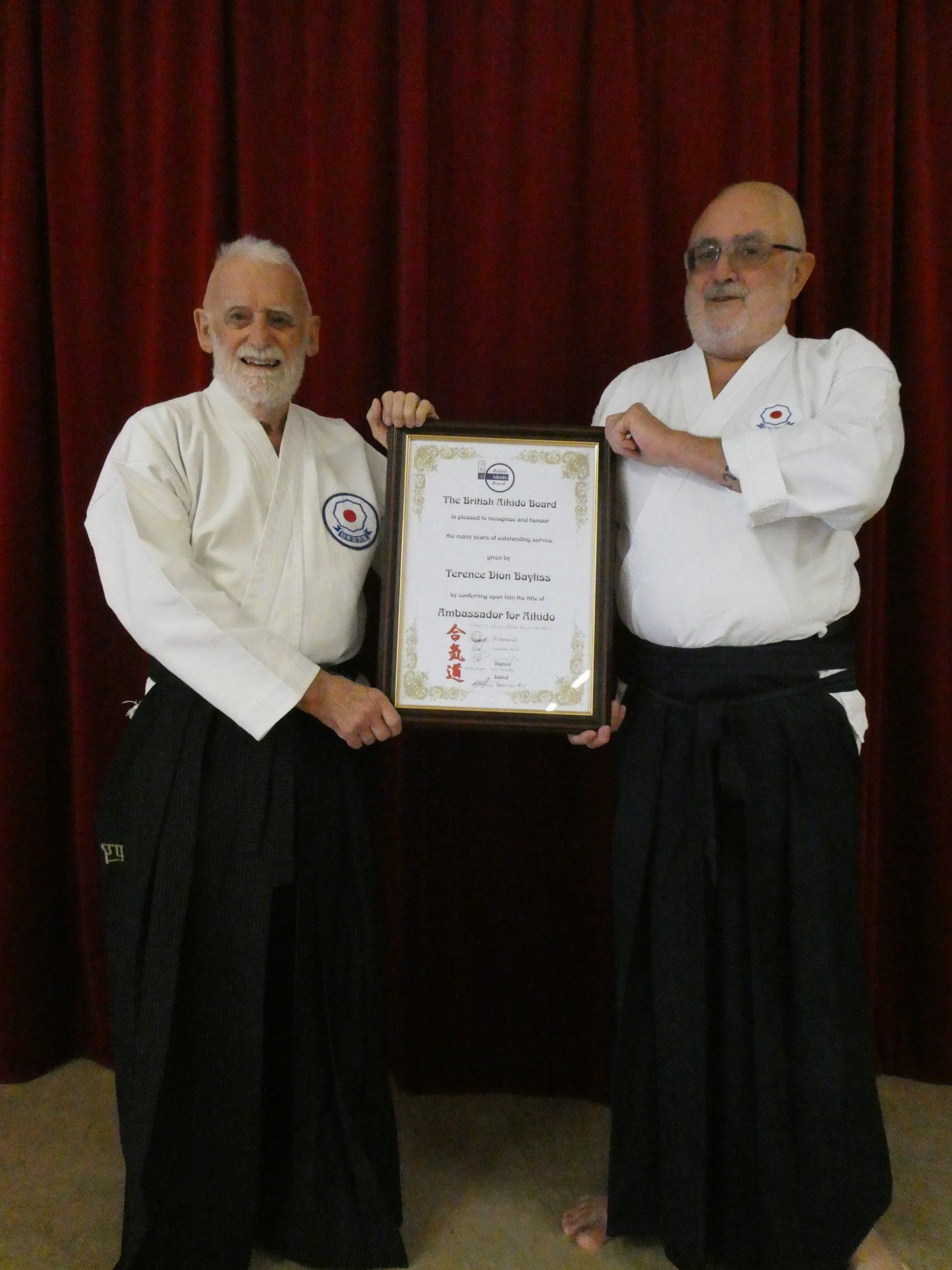 Sensei Bayliss and Sensei Sheridan with BAB certificate